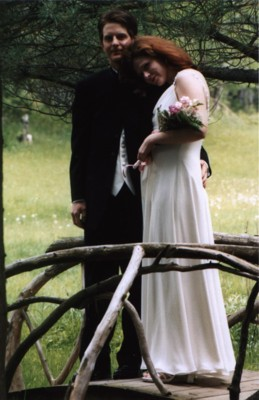 Standing on one of the branch-bridges that decorate the walkways, during our wedding photos.  (Note the belly... we found out just two weeks after mailing out the invitations!)